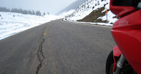 Ducati Multistrada Riding over a mountain in the snow