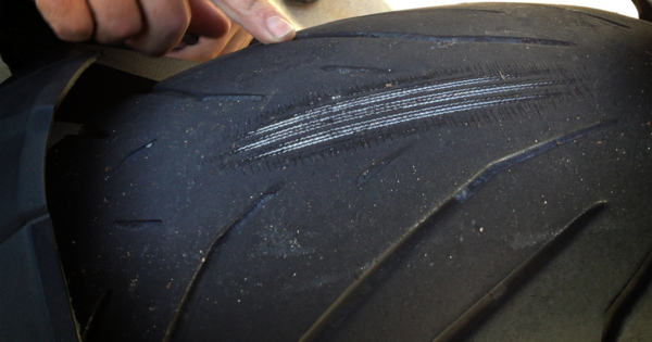 Worn out motorcycle tire cords showing