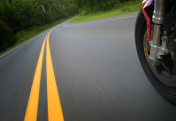 motorcycle trail braking into a corner