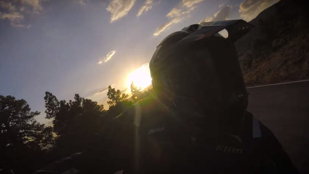 motorcycle riding at sunset